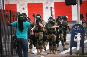 Photo By Scott Olson/Getty Images  FERGUSON, MO - AUGUST 11: Police force protestors from the business district into nearby neighborhoods on August 11, 2014 in Ferguson, Missouri.   Photo By Scott Olson/Getty Images